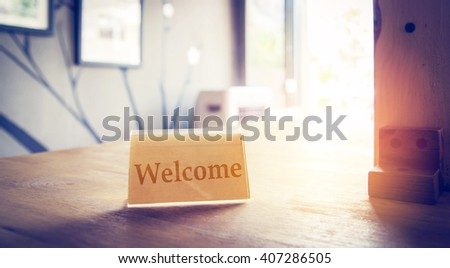 welcome sign on table cafe in coffee shop