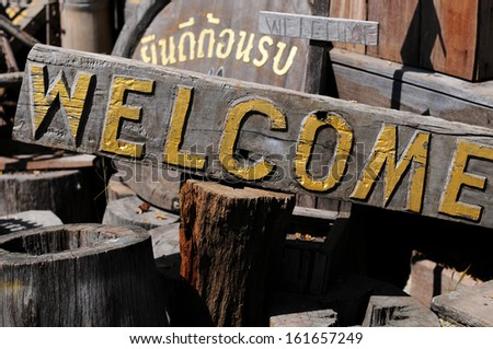 Welcome sign on the old wood.