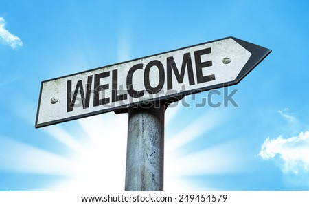 Welcome sign with a beautiful day - stock photo