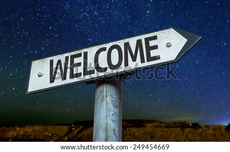 Welcome sign with a beautiful night background - stock photo