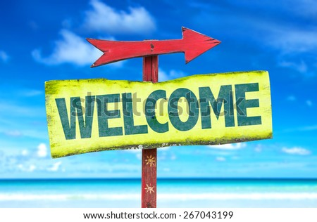 Welcome sign with beach background - stock photo