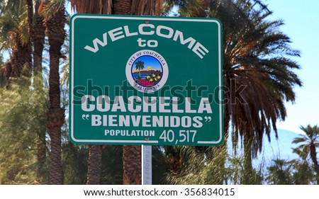 Welcome to Coachella, California road sign with palm trees backdrop - stock photo
