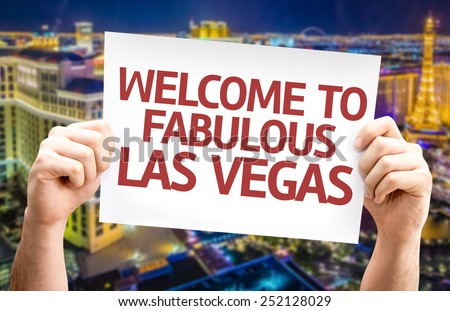 Welcome to Fabulous Las Vegas card with city background - stock photo