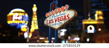 Welcome to Fabulous Las Vegas Neon Sign. Intentional Blurred Las Vegas Strip In Background - stock photo
