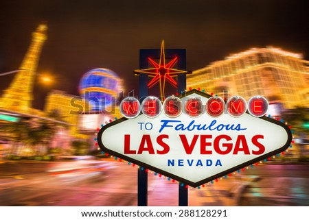Welcome to fabulous Las Vegas neon sign with Las Vegas strip road background - stock photo