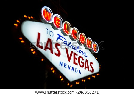 welcome to fabulous las vegas Nevada sign shot at night with a motion effect from the outside to the middle of the sign, effect done at the time of capture - stock photo