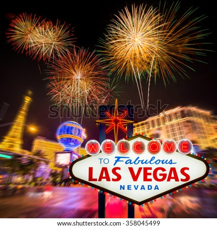 Welcome to fabulous Las vegas Nevada sign with blur firework and strip road background - stock photo