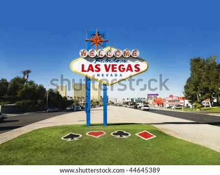 Welcome to Fabulous Las Vegas Nevada sign with urban buildings in background. Horizontally framed shot. - stock photo