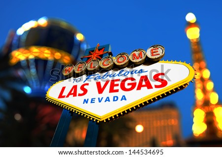 Welcome To Fabulous Las Vegas sign with night scene, Las Vegas, Nevada - stock photo