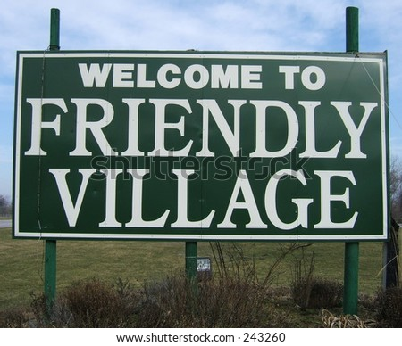 welcome to friendly village sign - stock photo