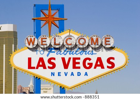 welcome to las vegas daytime with strip behind - stock photo