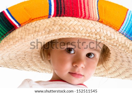 Welcome to Mexico says little girl with her Mexican hat and big brown eyes