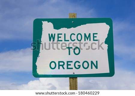 Welcome to Oregon sign against blue sky