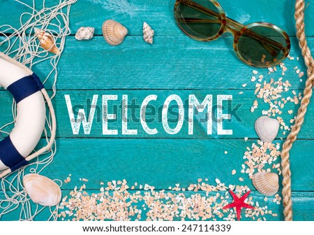 Welcome to the Beach - summer holidays concept with text and wooden background - stock photo