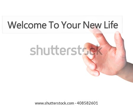 Welcome To Your New Life - Hand pressing a button on blurred background concept . Business, technology, internet concept. Stock Photo