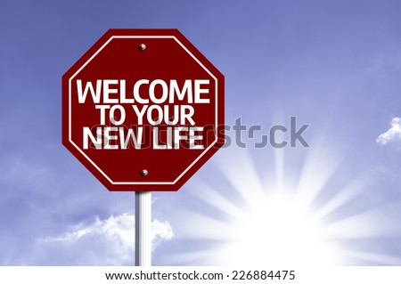 Welcome To Your New Life written on red road sign with a sky on background - stock photo