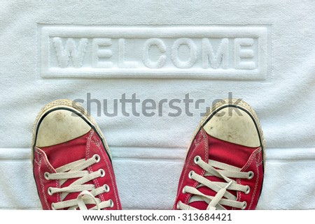 Welcome white carpet door mat  - stock photo