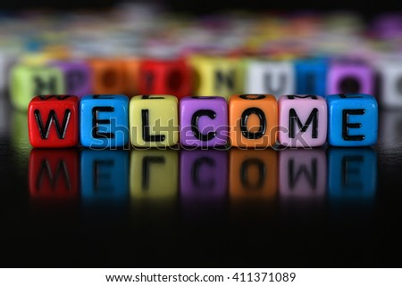 Welcome word written on colorful cube dice - stock photo