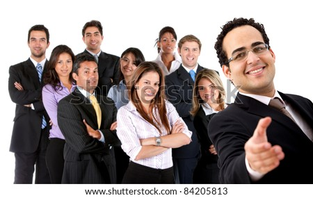 Welcoming business man ready to handshake with a group behind - isolated - stock photo
