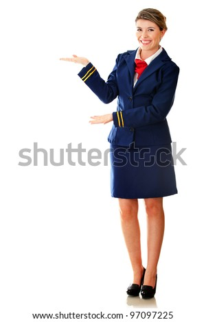 Welcoming flight attendant smiling - isolated over a white background - stock photo