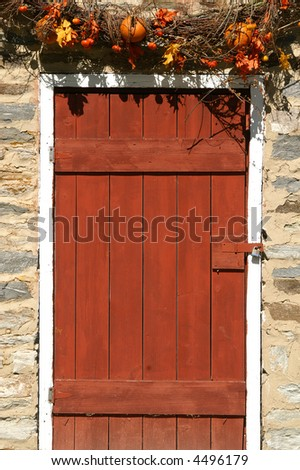 Welcoming Rustic Autumn Red Door - stock photo
