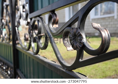 welded iron metallic fence flower detail closeup - stock photo