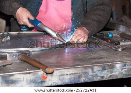welded steel iron metal - stock photo