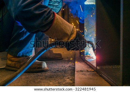 Welder and bright sparks. Production and construction - stock photo