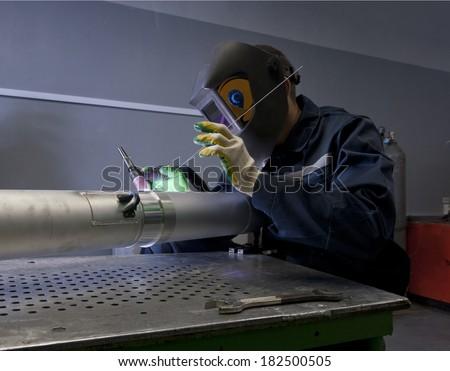 Welder argon welding for aluminum at work - stock photo