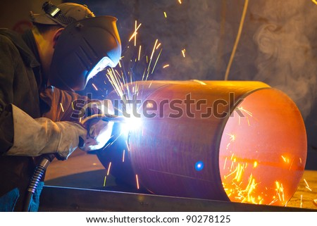 welder at factory work - stock photo