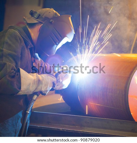 welder at factory work - stock photo