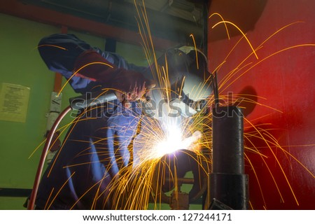 welder at work on location
