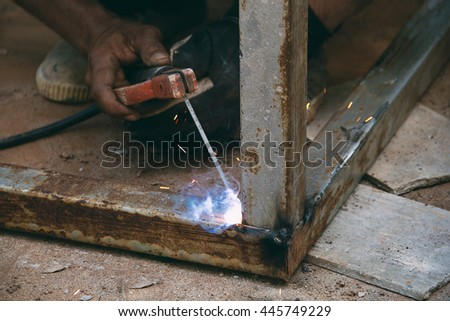 Welder at work, soft focus