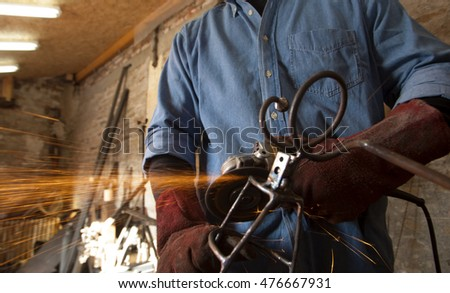 Welder holding a power tool, welding tool