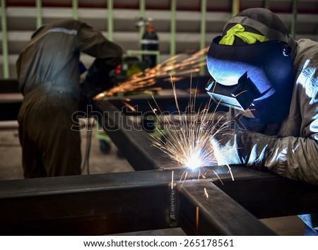 Welder in a factory - stock photo