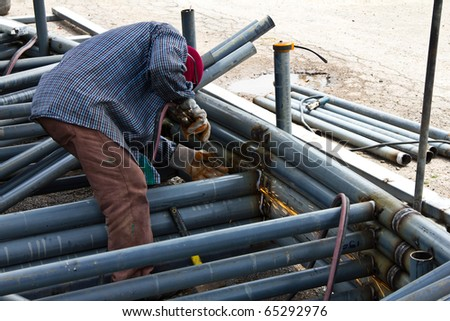 welder in construction - stock photo