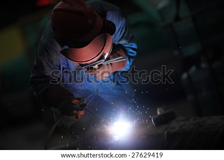 Welder in the middle of his job