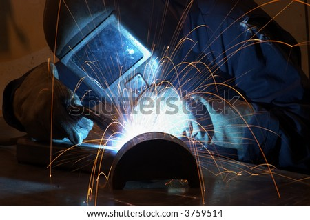 Welder in the middle of his job - stock photo
