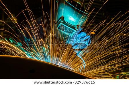 welder Industrial automotive part in factory - stock photo