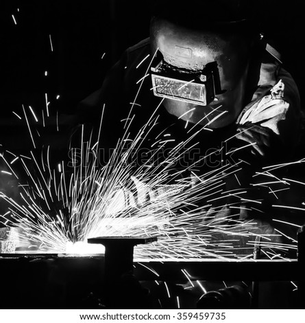 welder Industrial automotive part in factory black white - stock photo