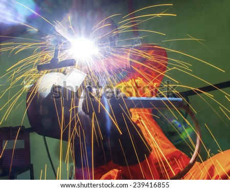 welder is working in location from bottom view - stock photo
