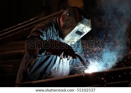 Welder man in work - stock photo