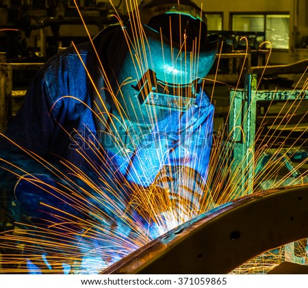 Welder man welding, spark, light and hot. Metal, iron work, and work. Mask and gloves for protection. Industry, industrial. - stock photo