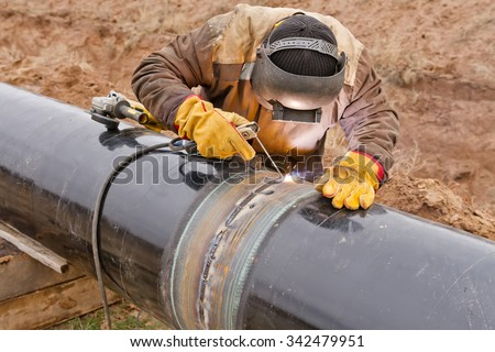 Welder mounts in the trunk pipeline electrochemical protection - stock photo
