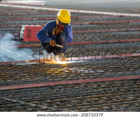 welder reinforce iron cage in a construction site - stock photo