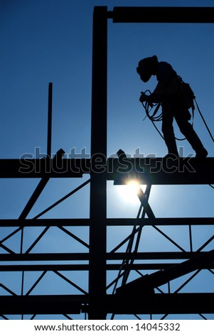 Welder Walks The High Steel - stock photo