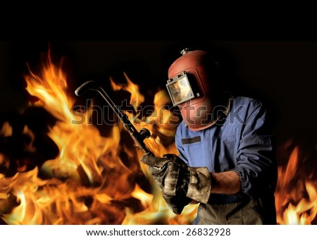 welder with flames around - stock photo