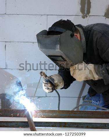 welder worker welding metal - stock photo