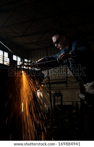 Welder working at the steel factory