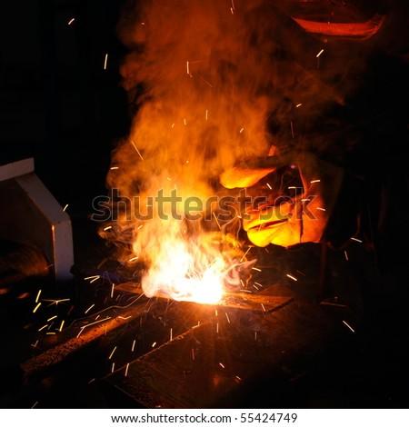 welder working in factory - stock photo